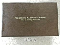 A Franklin Mint Offical Flags Of All Nations Set with Gold Flags, Case & Cards